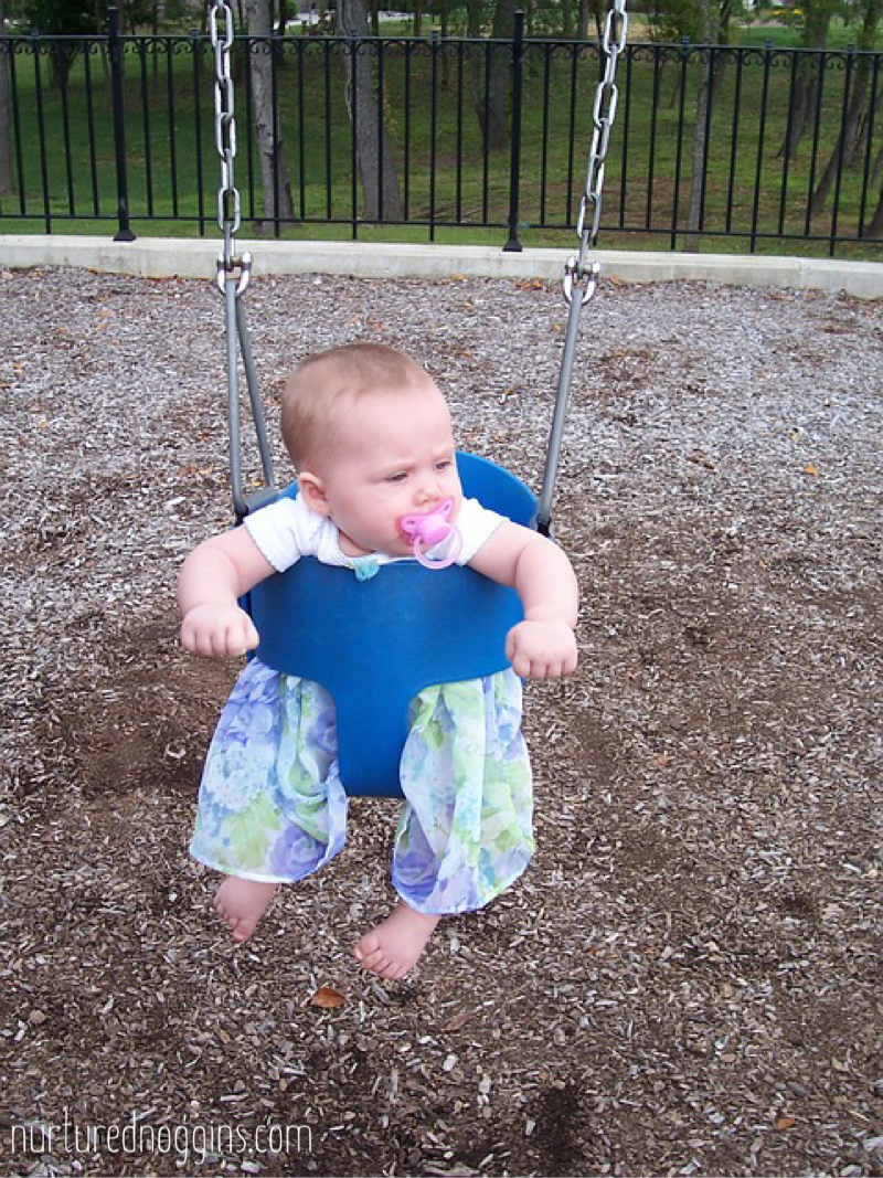 4 month old swinging park