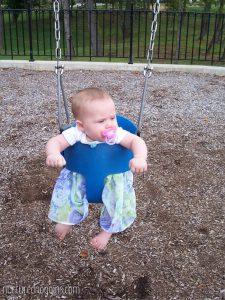4 month old swinging park