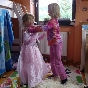 two little girls playing dress up