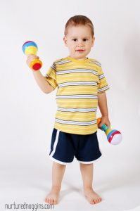 little boy toddler holding noise making toy